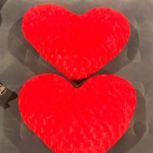 Two adorable puffed heart pillows from target